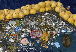 The boom skims up waste ranging in size from a discarded net and a car wheel to tiny chips of plastic. Photo credit: AP