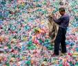 A Chinese labourer sorting out plastic bottles on the outskirt of Beijing. Photograph: Fred Dufour/AFP/Getty Images