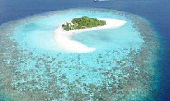 Islands in the Maldives - where sandy or gravel islands sit on top of coral reef platforms - are among those that could be affected by a global rise in sea levels. Credit: Gerd Masselink/University of Plymouth